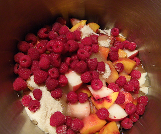 Pot filled with Peaches, Raspberries, Raw Sugar and Shot of Lemon