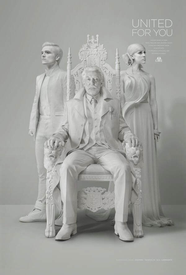 Johanna Mason, Peeta Mellark and President Snow in Mockingjay Part 1 Teaser Trailer #2 Capitol TV Statue