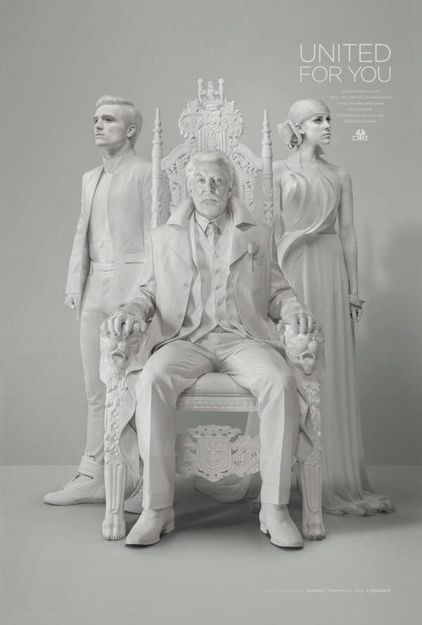 Johanna Mason, Peeta Mellark and President Snow in Mockingjay Part 1 Teaser Trailer #2 Capitol TV Statue