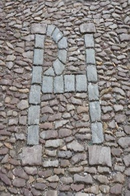 initials in cobbles where Patrick Hamiltion was burned at the stake