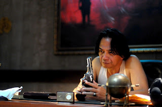 Ray Sahetapy as Tama in The Raid: Redemption