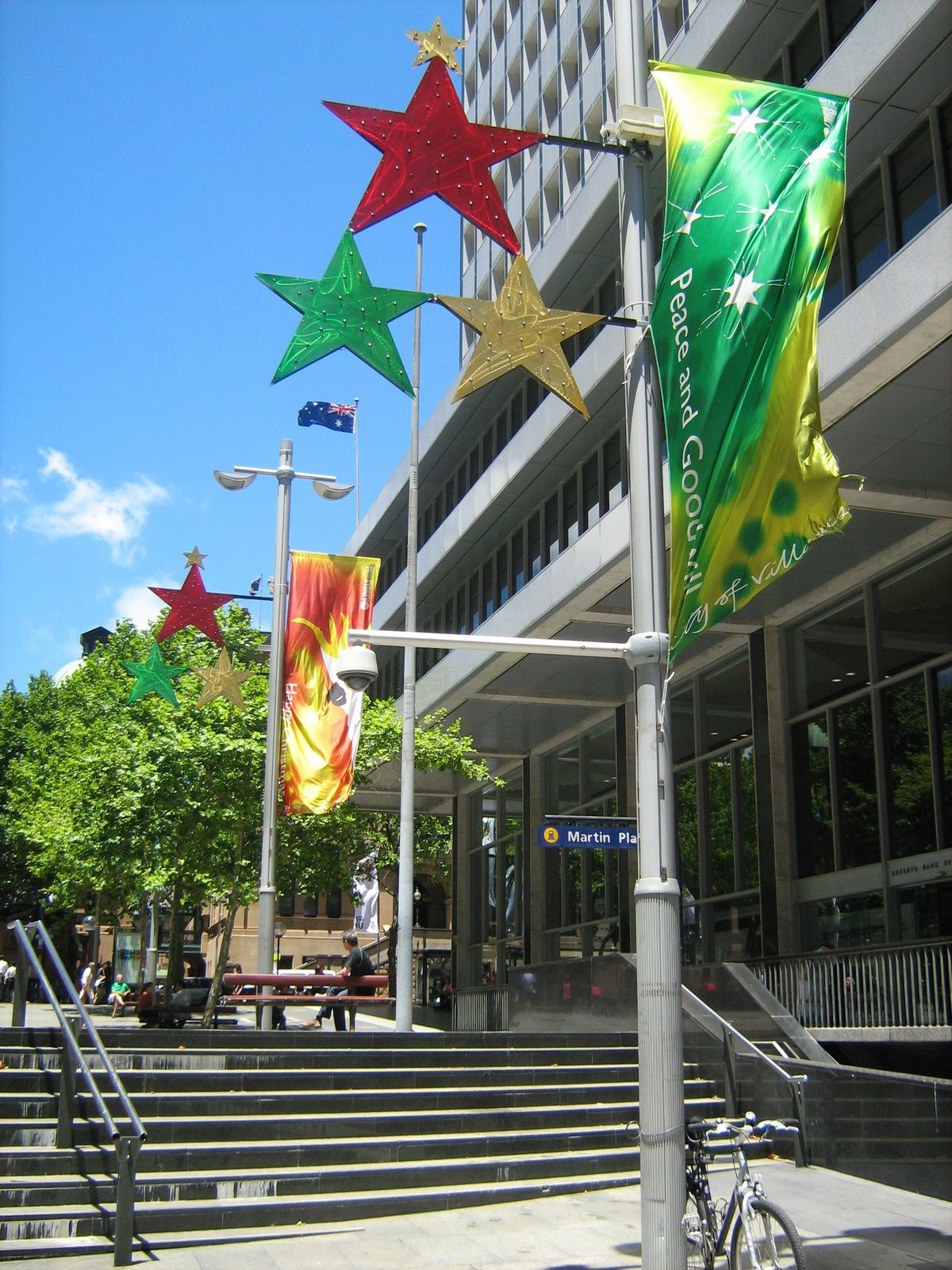 christmas banners and stars in red green and yellow adorn light poles throughout the city these banners and decorations are located outside the reserve