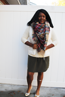 An outfit inspiration post featuring a J. Crew Factory puffer vest, plaid blanket scarf and cream flats.