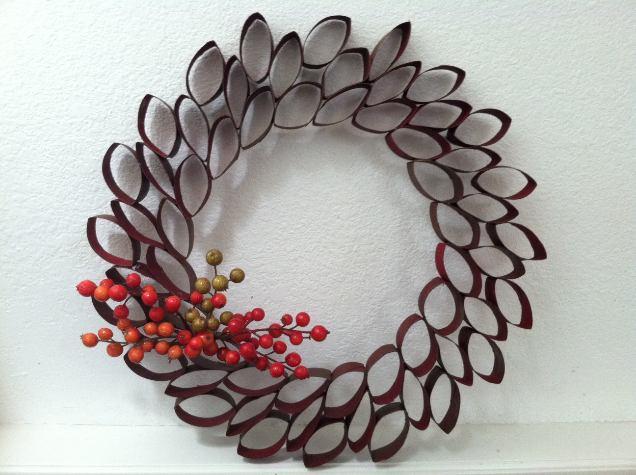 i was inspired to save many toilet paper rolls because i wanted to make a holiday wreath inspired