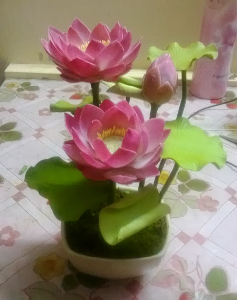 Clay flowers and figurines lotus arrangement
