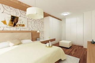 Quarto de casal com mobiliário em madeira