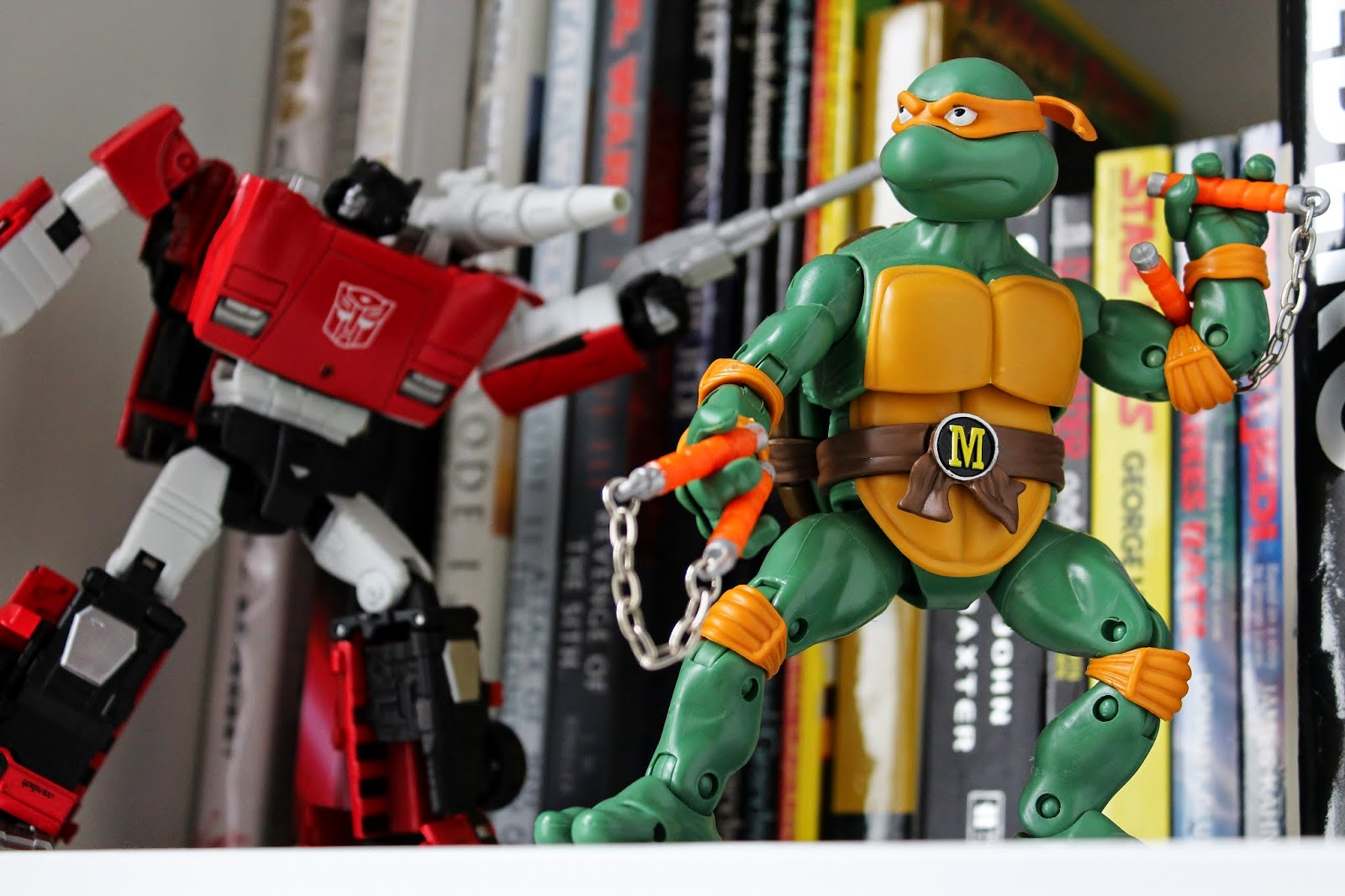 Transformers Masterpiece Sideswipe and TMNT Classics Michelangelo on the shelf | The Mos Espa Collection