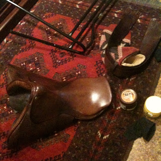saddle being cleaned