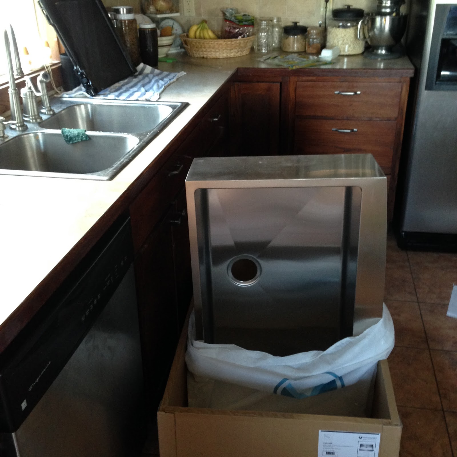 New Stainless Steel Apron Front Sink how we installed it in existing cabinetry