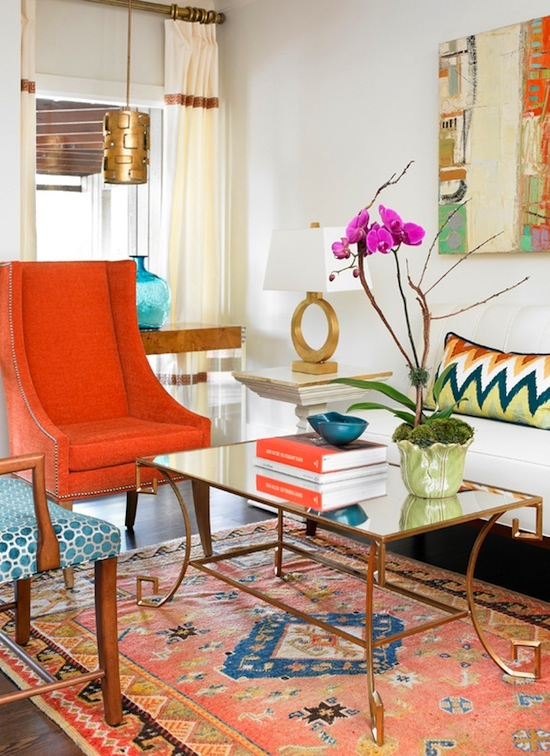 eclectic transitional living room with brass mirror coffee table
