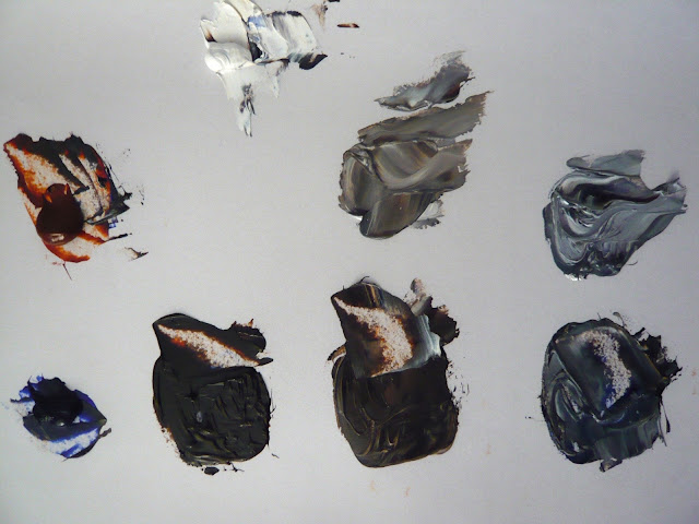 palette of pre-mixed grey oil paints