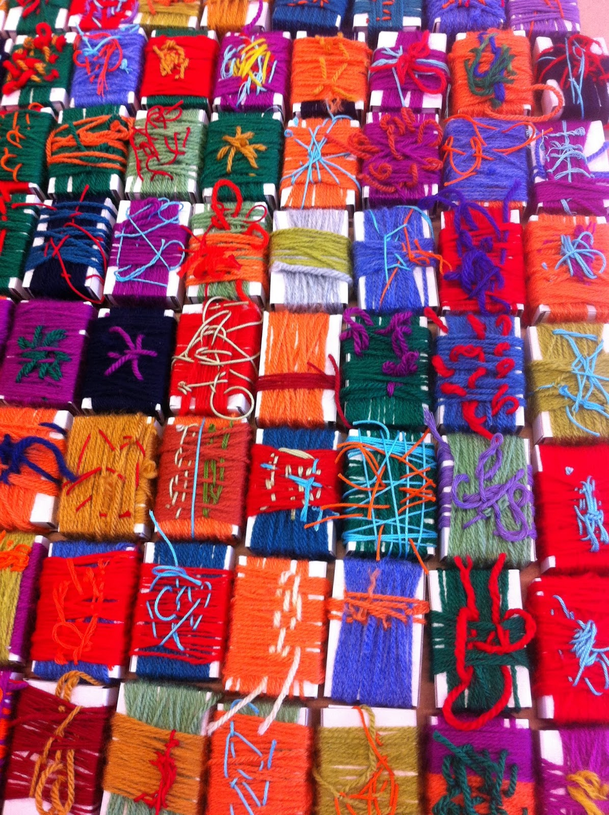 Matchbox wrapping textile project Years 1 - 4  Glue gunning in progress