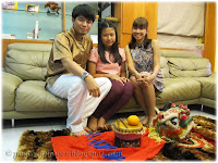 Family photo of Darren, Dylea and Yanti, from left to right