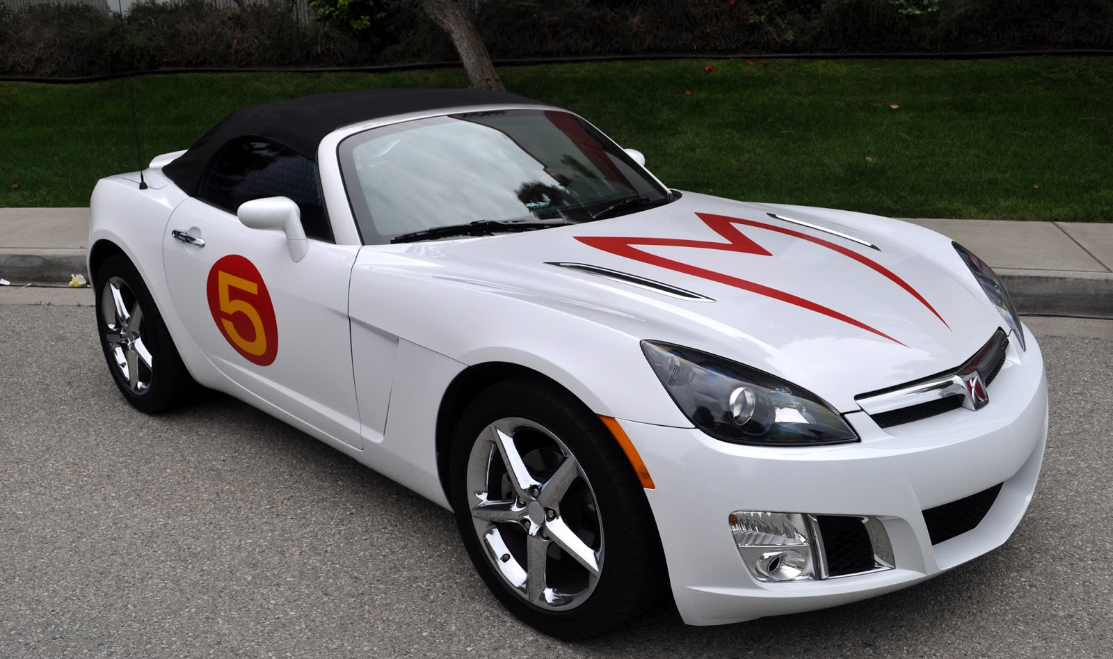 Cool Idea, Put The Mach 5 Graphics On A White Car.