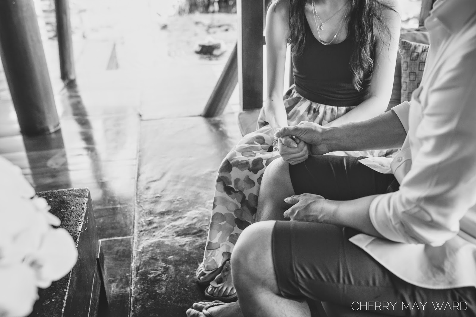thumb war, a fun couple playing thumb wars during photo session, fun engagement photo session on Koh Samui