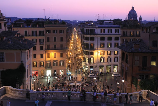 The evening view of the city of Rome from the top hill of Spanish Steps in Italy