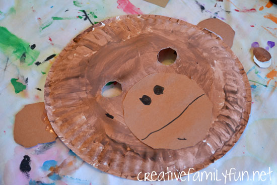 The girls glued their mouth and ears onto their paper plates and used a black marker to add the details. & All About Monkeys: A Learning Basket - Creative Family Fun