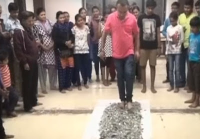 Gujarat government has ordered a probe into a private coaching class teacher, Rakesh Patel, who made his students walk on broken glass pieces.  The Vadodara-based tuition teacher reportedly made his 70 students indulge in the dangerous act on Tuesday.  A video footage shows a line of students walking barefoot on a pile of glass pieces spread on the floor of the institute.