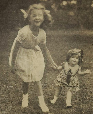 A little girl with copy-cat hair and a Shirley Temple doll, 1936