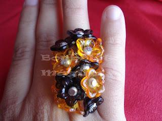 Os meus aneis de flores Anel%2BFlores%2Bpretas%2Be%2Blaranjas