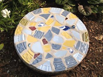 Crafting a mosaic garden stone...