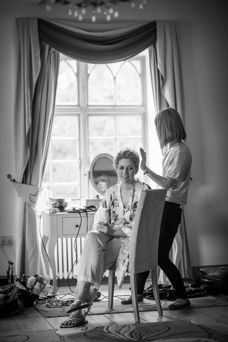 Bride Alison relaxes while Louise Chrystal adds the finishing touches to her classic bridal hairstyle