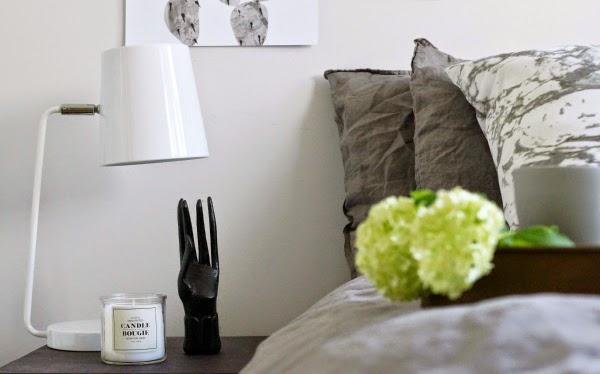 wooden hand white desk lamp grey linen sheets bedroom