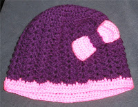 http://winnieswishauction.blogspot.com/2015/11/item-82-purple-and-pink-crocheted-hat.html