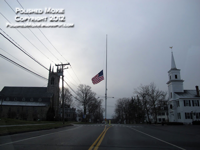 Image of flag at the center of Newtown CT.