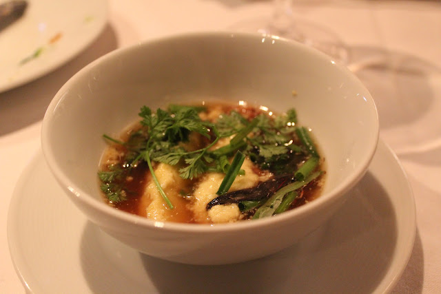 Wild mushroom consomme at 80 Thoreau, Concord, Mass.