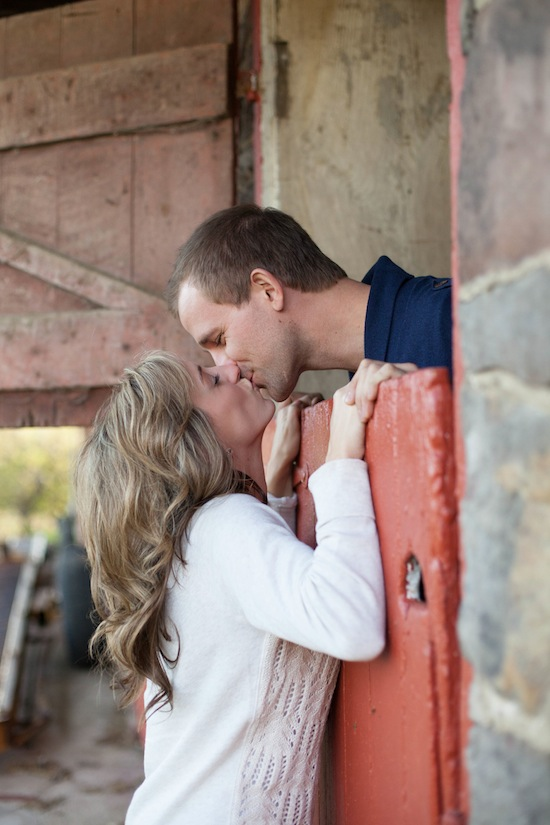 couple kissing over a stable door