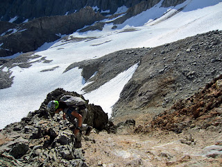 The beginning of the chute of the alternate route, which has the brownish/orange colored rock. Very steep and loose.