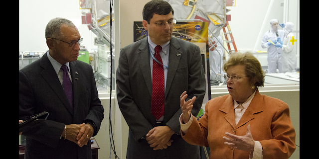 NASA Administrator Charles Bolden, NASA Goddard Center Director Chris Scolese and Maryland Senator Barbara Mikulski talk to the press during their tour of the NASA Goddard facilities. They are standing outside a clean room for the Magnetospheric Multiscale Mission (MMS). Image Credit: NASA/Goddard/Rebecca Roth