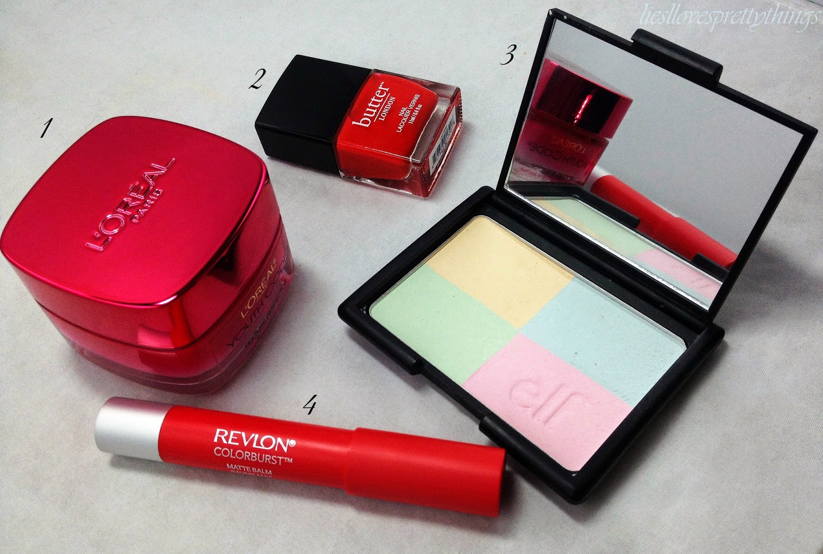 July Favorites-- L'Oreal Youth Code Texture Perfector day/night cream, Butter London Ladybird, e.l.f. Tone Correcting Powder, Revlon Colorburst Matte Balm in Striking