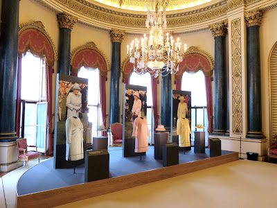 Three of the Queen's state outfits in a Royal   Welcome 2015 exhibition at Buckingham  Palace   Photo © Andrew Knowles