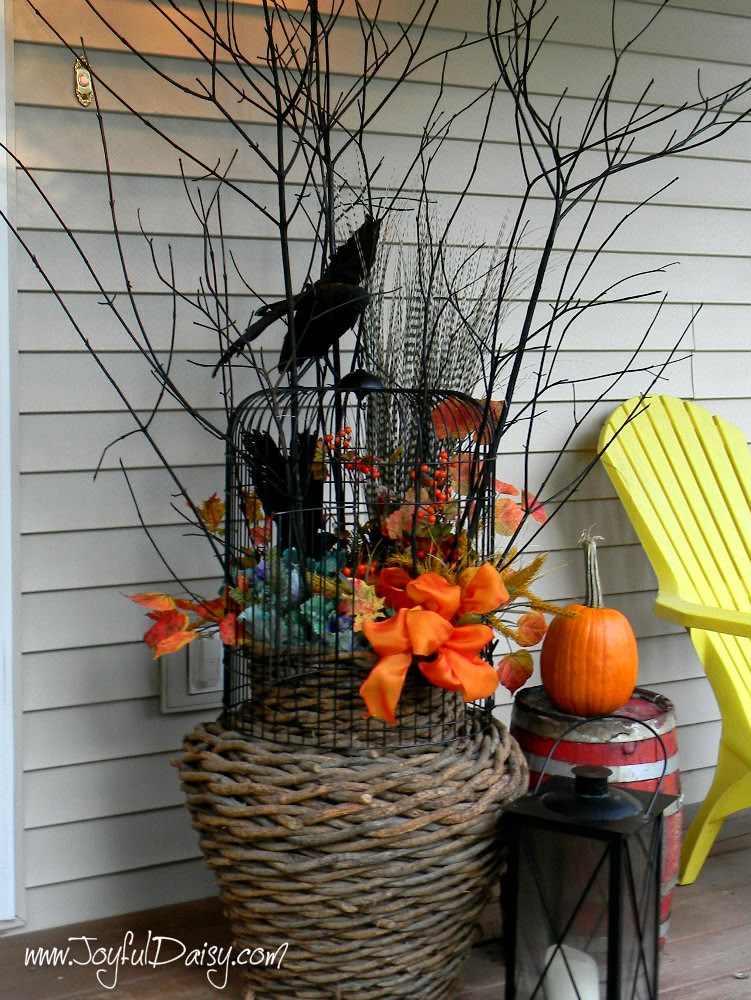 http://joyfuldaisy.com/fall-porch-decorations-birdcage-twig-urn/