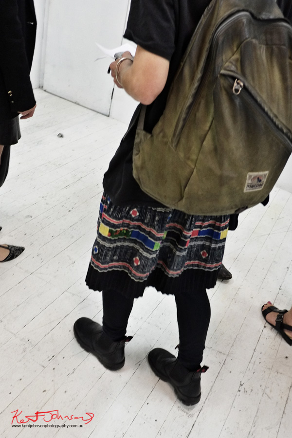 Black pleated skirt with vintage 50's geometric fabric pattern. Redback work boots, vintage Macpac backpack. Street Fashion Sydney.