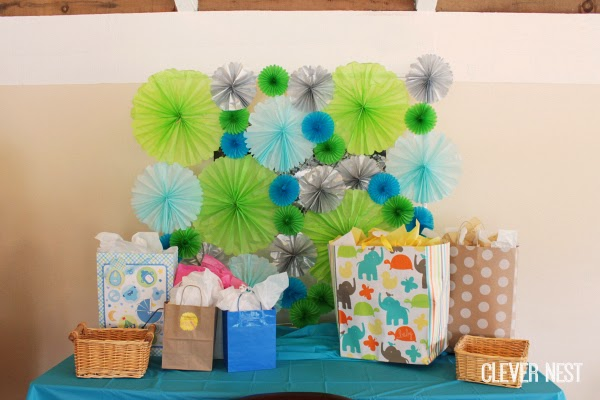 good idea to use paper fans as a backdrop for presents or taking pictures #turquoisegraylime #littleman #hipsterbabyshower #glasses #bowtie #clevernest #bowtienapkins #babyshowergame