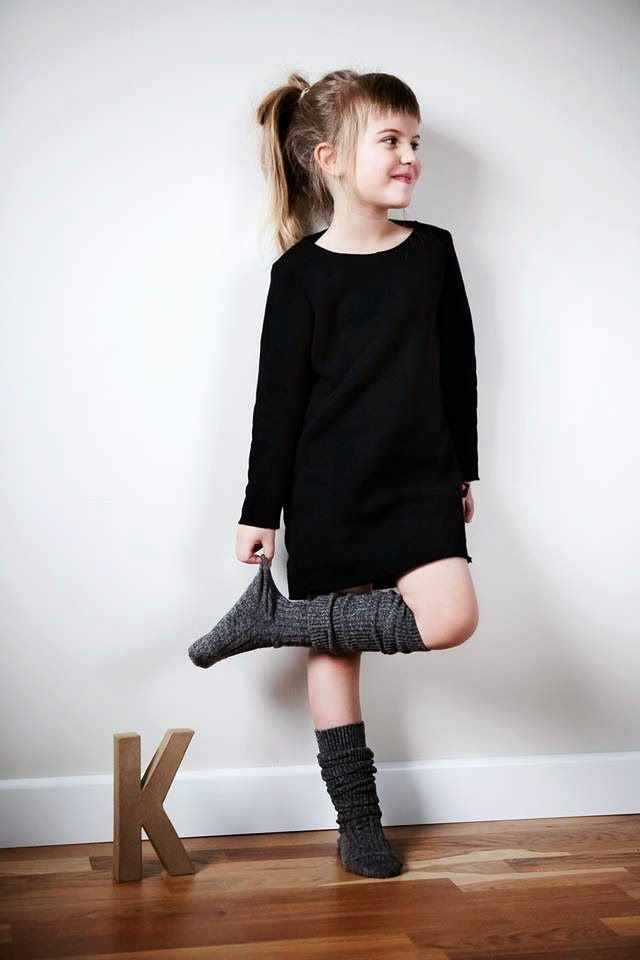 Black kids dress in brushed knit by Polish kidswear brand Kujukuju