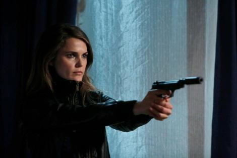 Keri Russell firing a gun