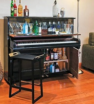 turn an old piano into a bar station with this creative tutorial
