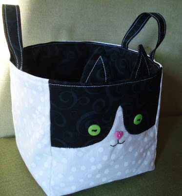 fabric bucket with a tuxedo cat design