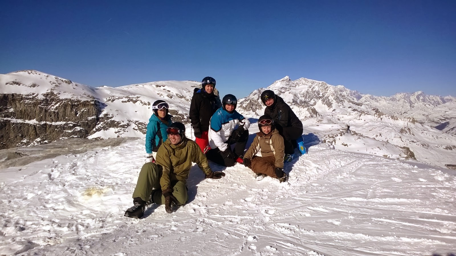 159 Supply Regiment's skiing team in front of some snowy mountains in France.
