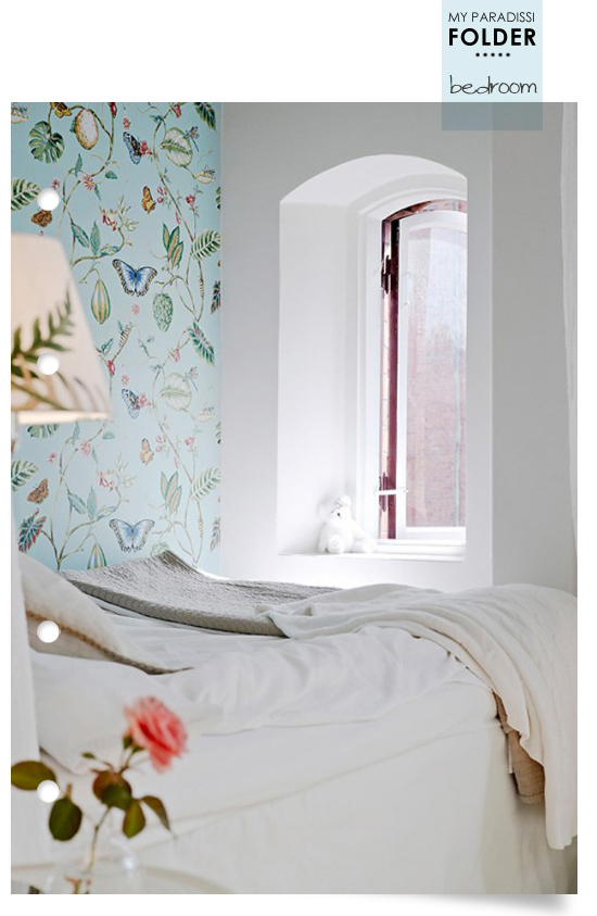 Bedroom with wallpaper and arched window