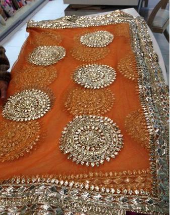 orange and pinkk mehndi and sangeet lehenga inspirations