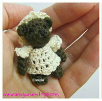 small crocheted bear with dress