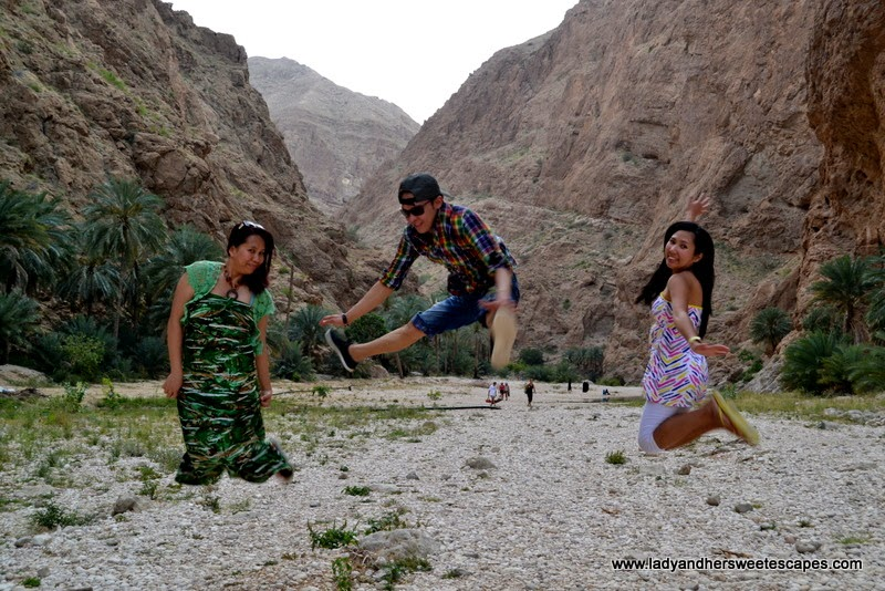 jumping for joy in Wadi Shab Oman