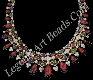 A multi-coloured necklace of rubies, sapphires, emeralds and diamonds, set in gold in the manner of traditional Indian kundan work, created by Mauboussin in 1967.
