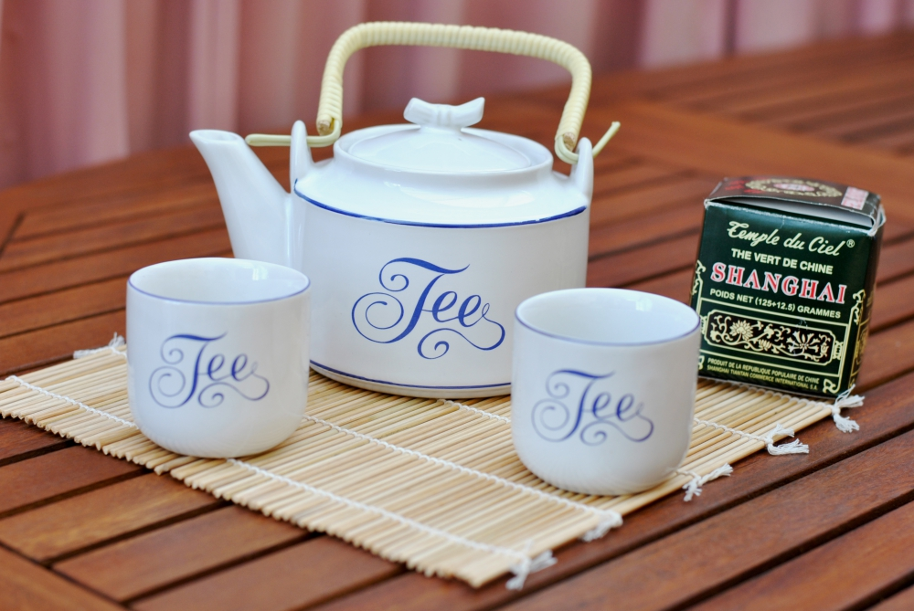 asian style tea pot and mugs