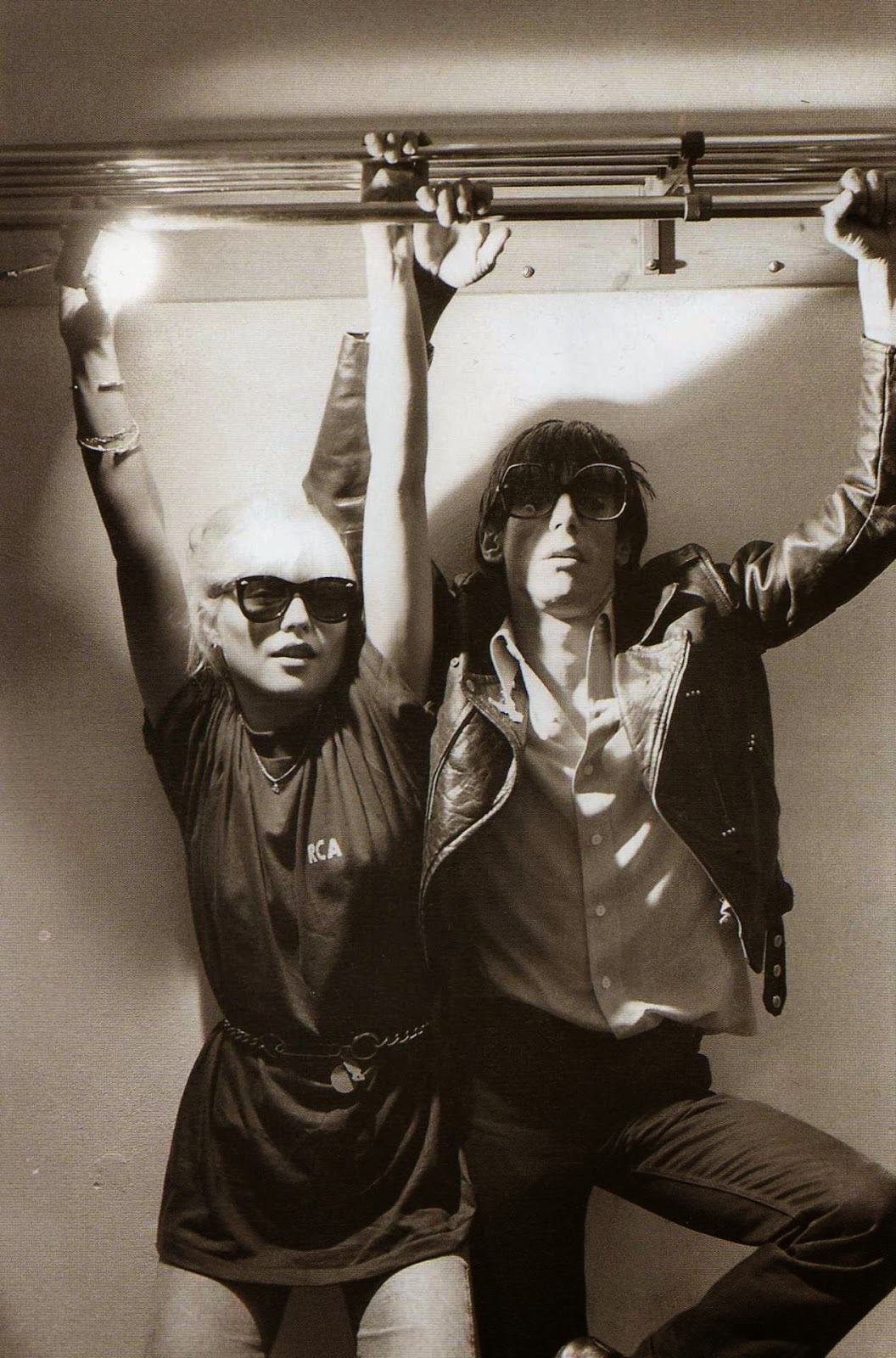 blondie with their hands up